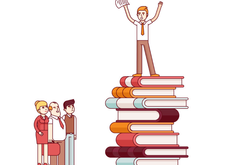 Person standing on books while doing public speaking