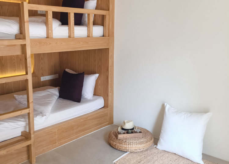 wooden, clean beds in the Hostel