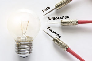 Data, integration and solution darts point at idea bulb