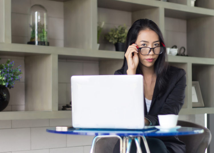 Woman Focused on Working on Her Laptop