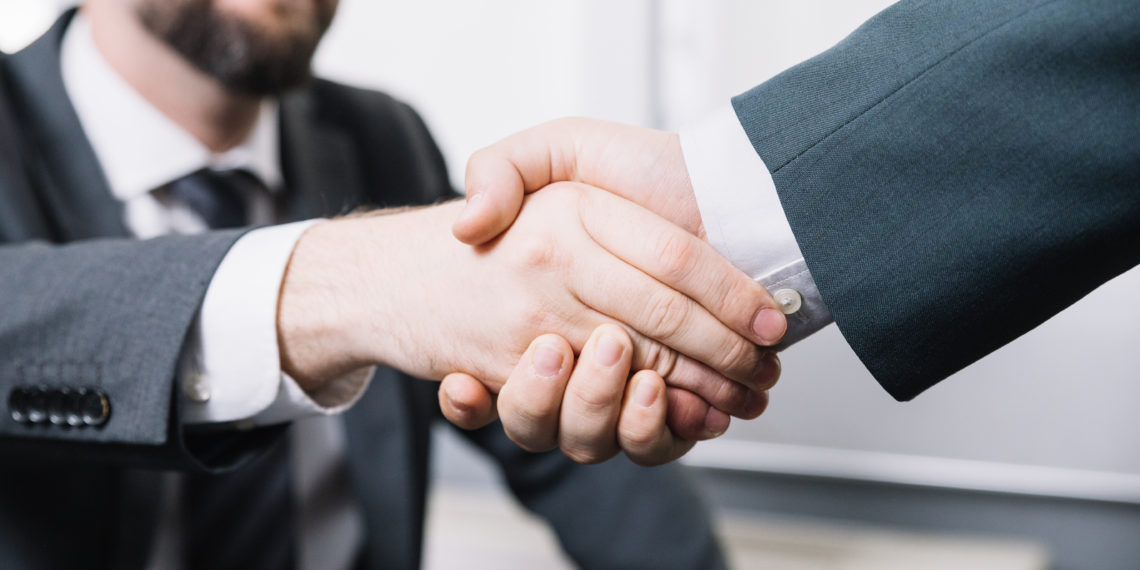 Businessman making a deal with the small company accountant
