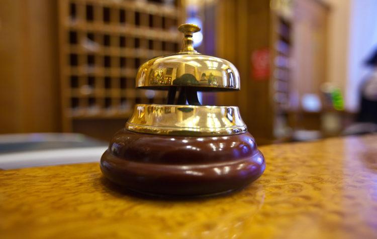 Golden Bell On Reception Desk In Hotel