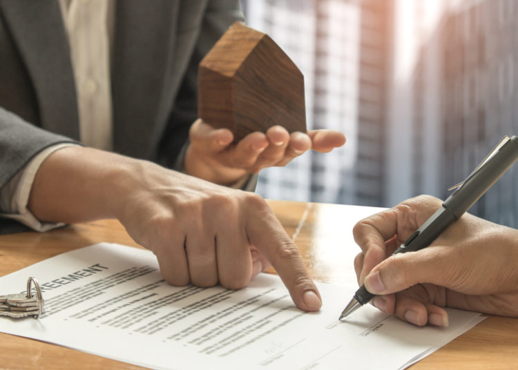 Property Manager Signing Lease Agreement