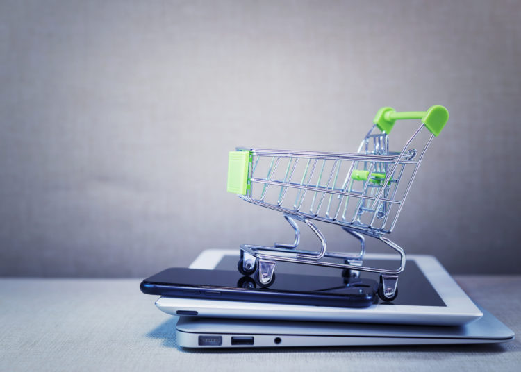 Shopping basket on top of items of online network connection. Selling and payment concept.