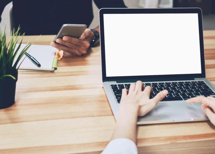 Women using a laptop on white screen, on-line marketing