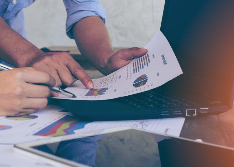 Business people brainstorming at office desk, financial adviser