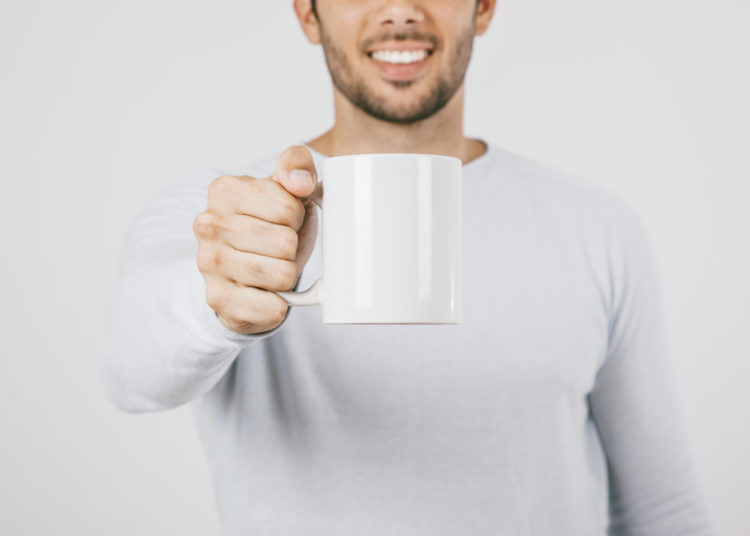 Smiling man with a mug, promotional product for company