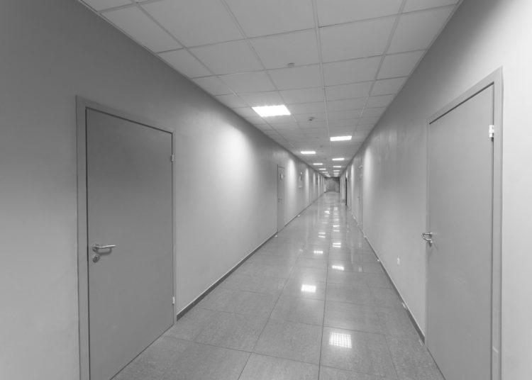 A long corridor with doors.